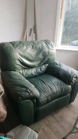 Green leather reclining amrchair