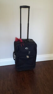 American Tourister Suitcase – Pull-up Handle & 2 Wheels
