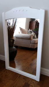 White mirror in wooden frame