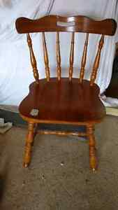 2 solid wood dining chairs.