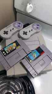 SNES with Super Mario World and Mario Kart
