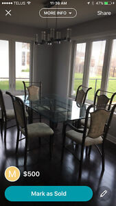 Beautiful glass dinning room table and 6 chairs Cornwall Ontario image 1