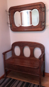 Antique hall seat and ornate matching mirror