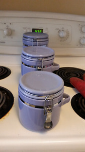 3 purple canisters