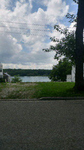 Riverfront property in Corunna with boatlift.