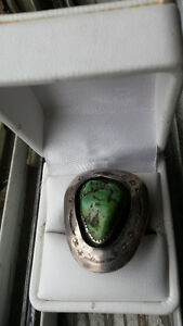 RING INDIA GREEN JADE SIZE 11 BOUND BY STERLING SILVER.