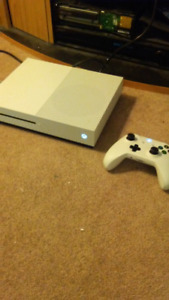 Selling Xbox one S with controller charger (& 3 games) for 250$