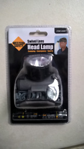adjustable swivel head lamp . New  & includes batteries