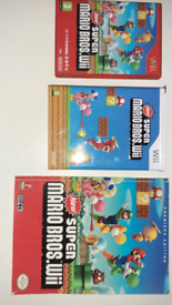 Mario Wii edition game, collectors tin and players guide