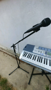 Keyboard with stand and mic with stand.