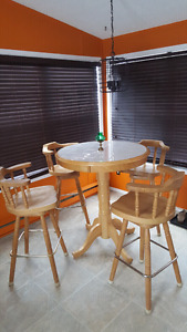 Bar table with swivel chairs