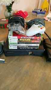 XBOX 360 WITH 7 GAMES AND 2 CONTROLLERS