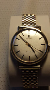 1960s 9 karat gold watch and band