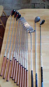 Men's golf clubs (right) , bag and pull cart with other stuff