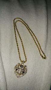 King Ice 14k gold iced out lion chain