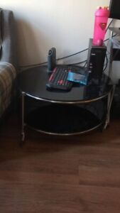 Black glass round coffee or end table in great shape.