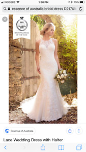 Beautiful designer Lace wedding gown.  Never worn, tags on.