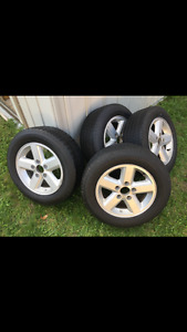 Selling a set of rims and tires 225/60/16