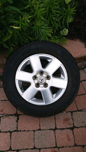 4 four season 215/65/R16 tires with mags rims