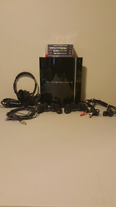 Excellent condition PS3 with 5 games and extras