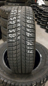 A set of 4 Michelin snow tires. 185/65/15