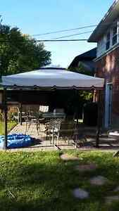 Awning with sides, table and chairs