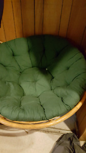Circle chair with green cushion
