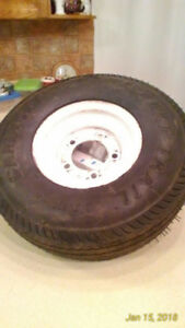 Trailer tire on rim. Never used