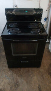 Black KitchenAid coil top stove with convection oven