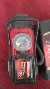 Air compressor and traction aids