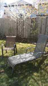 Padio lounger and chair and stone fireplace