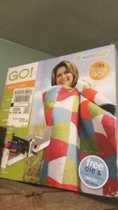 Accuquilt GO fabric cutter with extras