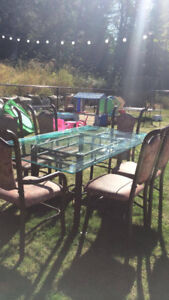 Wraught iron glass table and 8 chairs