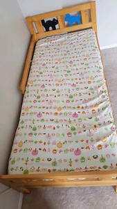 Two ikea toddler beds with mattresses