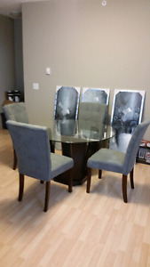 Round glass table with 4 microfiber chairs