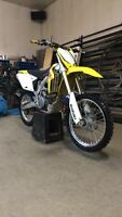 2009 RMZ 450 trade for 850 or 550 sportsman or $4500
