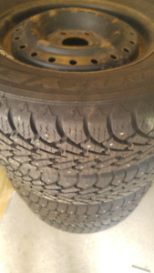 P215-70-16 GOODYEAR WITH STUDS ON GRAND CARAVAN RIMS   $300.00