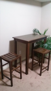 Wood Breakfast table with two stools