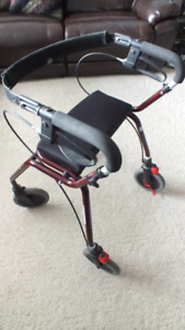 Walker with wheels and hand brakes - like new condition