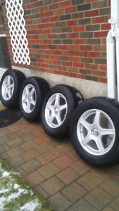 Core Racing Rims with Artic Claw Winter 235/65/R17