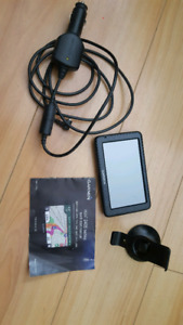 Garmin Nuvi GPS System with charger, mount holder and manual