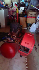 Coleman air compressor with 100' roll up $300