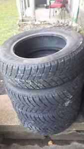 Set of four 185/65r14 winter tires for sale