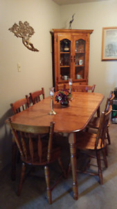 Birch diningroom table with 6 chairs and corner cabinet.