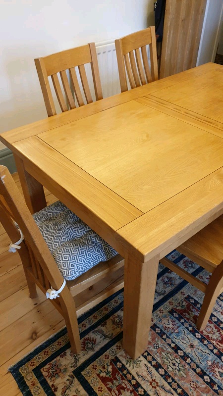 Used solid oak extending dining table and 6 chairs.   in ...