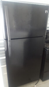 2 black fridges and 2 black self cleaning stoves  1 coil  1 gas