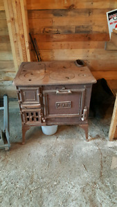 Vintage wood stove with cook top