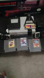 Nes games, game genie and cleaning system