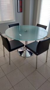Contemporary Glass and Chrome table with 4 black Chairs