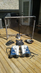 street hockey pads with net, goalie stick and helmet